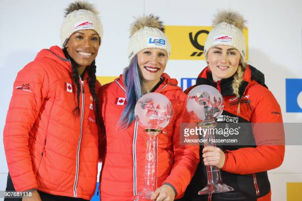 Kaillie Humphries Melissa Lotholz and Phylicia George of Canada celebrate winning the overall World Cup at Deutsche Post Eisarena Koenigssee after...