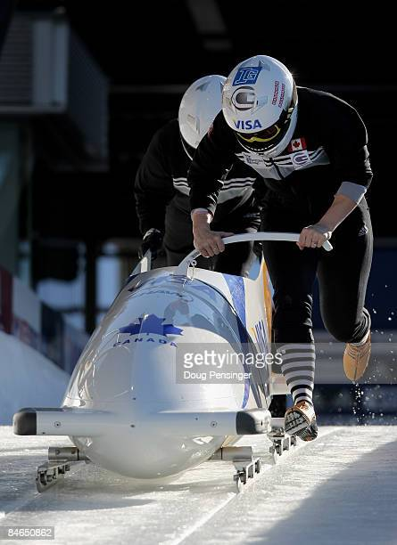 Kaillie Humphries of Canada and her brakeman push from the start during bobsleigh training at the Bobsleigh and Skeleton World Cup at the Whistler...