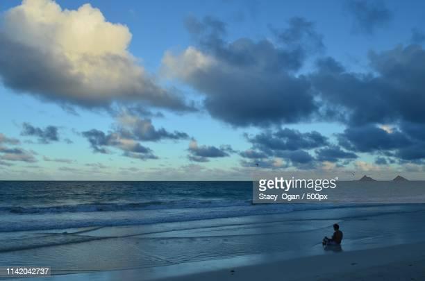 kailua beach meditation - kailua beach stock photos and pictures