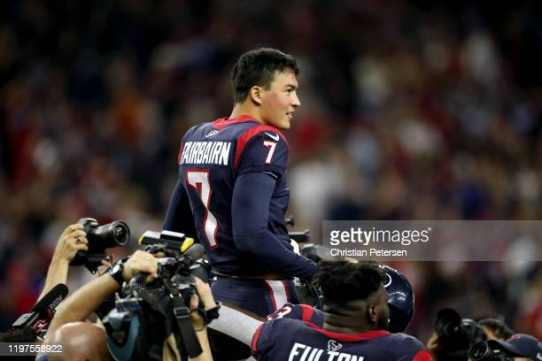 Ka'imi Fairbairn of the Houston Texans is carried by his teammates after his gamewinning field goal in overtime to give his team the 2219 win against...