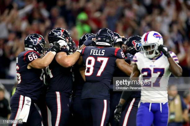 Ka'imi Fairbairn of the Houston Texans is congratulated by his teammates after his gamewinning field goal in overtime to give his team the 2219 win...