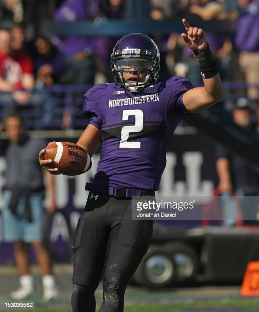 Kain Colter of the Northwestern Wildcats celebrates his first touchdown of the game against the Indiana Hoosiers at Ryan Field on September 29, 2012...