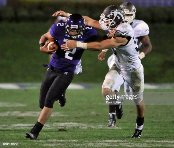 Kain Colter of the Northwestern Wildcats is tackled by Justin Currie of the Western Michigan Broncos during the fourth quarter on September 14 2013...