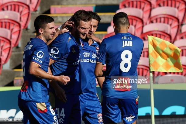 Kaine Sheppard of the Jets celebrates his goal with team mates during the round seven ALeague match between the Newcastle Jets and the Brisbane Roar...