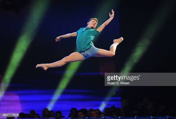 """Kaine Ward performs prior to being announced as a finalist during the second live show of 2014's """"Got To Dance"""" at Earls Court on August 26, 2014 in..."""