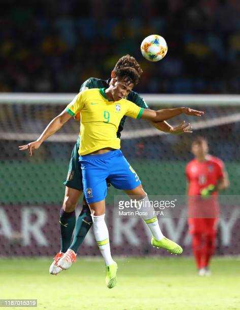 Kaio Jorge of Brazil challenges for the high ball with Christian Dalle Mura of Italy during the FIFA U-17 World Cup Quarter Final match between Italy...