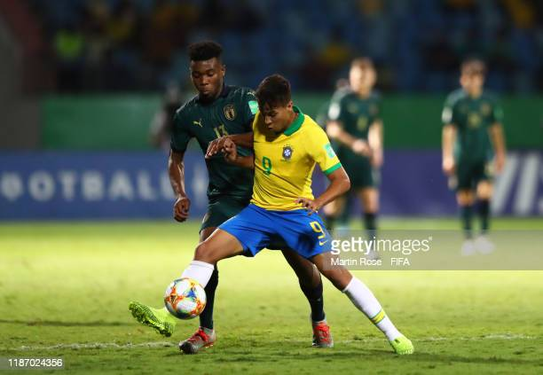Kaio Jorge of Brazil looks to break past Iyenoma Udogie of Italy during the FIFA U-17 World Cup Quarter Final match between Italy and Brazil at the...