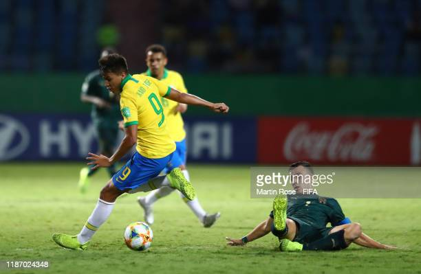 Kaio Jorge of Brazil looks to break past Simone Panada of Italy during the FIFA U-17 World Cup Quarter Final match between Italy and Brazil at the...
