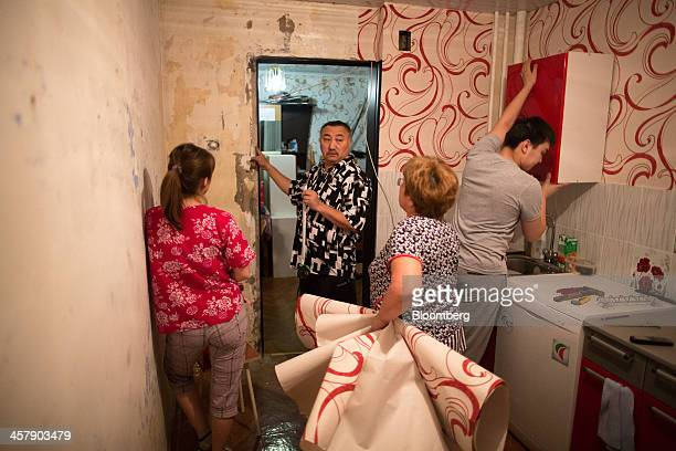 Kairat Zhakizhanov a Kazakh mine worker center and his family use wallpaper to redecorate their kitchen area in Udachny Sakha Republic Russia on...