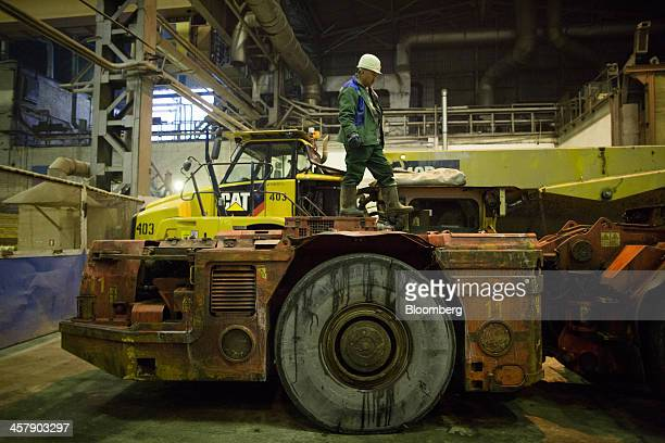 Kairat Zhakizhanov a Kazakh mine worker walks across his loader vehicle to inspect it during maintenance at the motor depot at the OAO Alrosa...