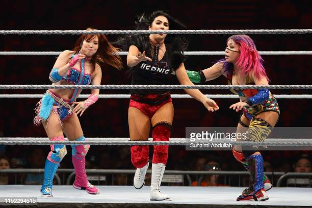 Kairi Sane and Asuka compete against Billie Kay of The IIconics during the WWE Live Singapore at the Singapore Indoor Stadium on June 27, 2019 in...