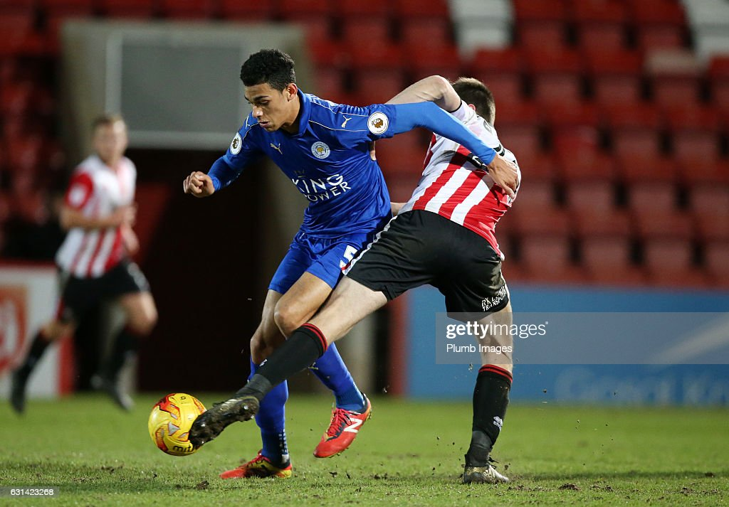 Kairo Mitchell of Leicester City in action with James Dayton of Cheltenham Town during the EFL Checkatrade Trophy Second Round tie between Cheltenham Town and Leicester City at Whaddon Road Stadium on January 10, 2017 in Cheltenham, England.