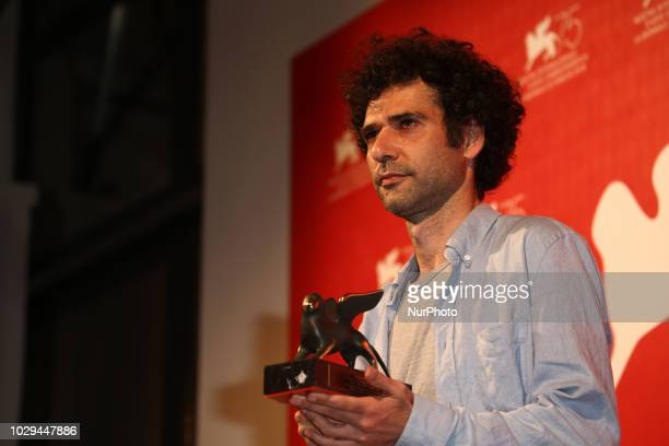 Kais Nashif poses with the Orizzonti Award for Best Actor Award for 'Tel Aviv On Fire' at the Winners Photocall during the 75th Venice Film Festival...