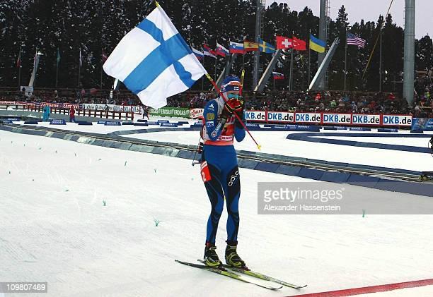 Kaisa Maekaeraeinen of Finland celebrates winning the women's 10km pursuit during the IBU Biathlon World Championships at A.V. Philipenko winter...