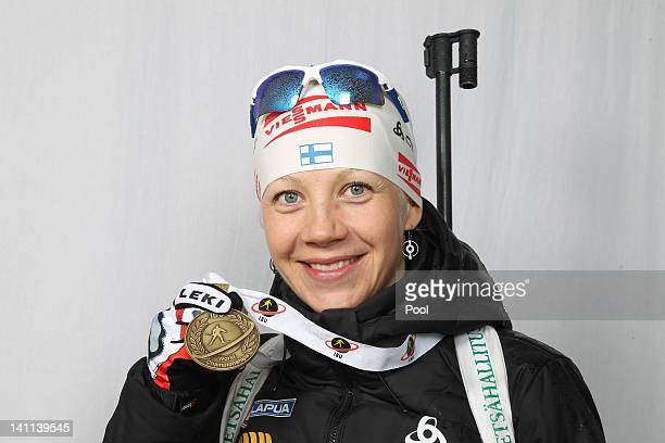 Kaisa Maekaeraeinen of Finnland shows her medal of the IBU Biathlon World Championships Women's Mass Start on March 11 2012 in Ruhpolding Germany