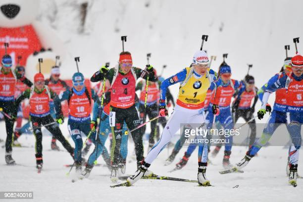 Kaisa Makarainen of Finland and Laura Dahlmeier of Germany compete in the Women's 125 km Mass Start Competition of the IBU World Cup Biathlon in...