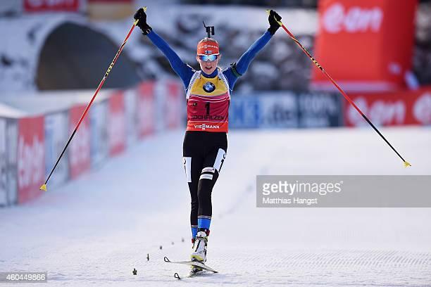 Kaisa Makarainen of Finland celebrates at the finish winning the women's 10 km pursuit event during the IBU Biathlon World Cup on December 14, 2014...