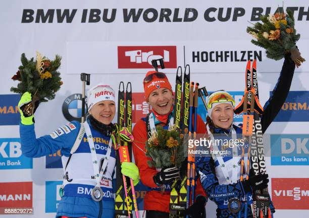 Kaisa Makarainen of Finland celebrates second place Anastasiya Kuzmina of Slovakia celebrates first place and Darya Domracheva of Belarus celebrates...