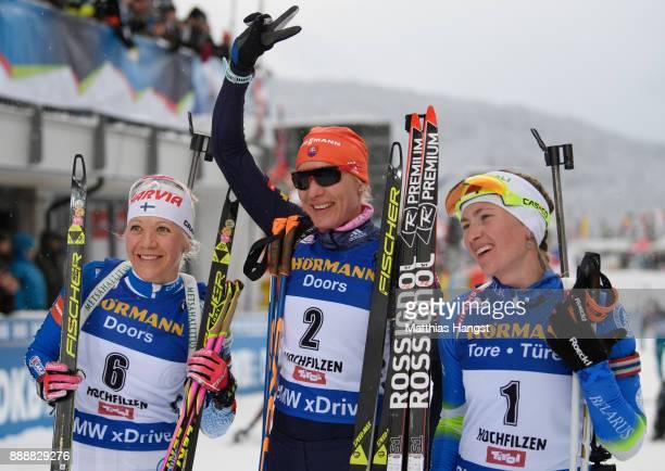 Kaisa Makarainen of Finland celebrates second place, Anastasiya Kuzmina of Slovakia celebrates first place and Darya Domracheva of Belarus celebrates...