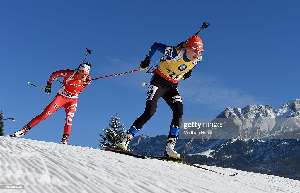 Kaisa Makarainen (R) of Finland competes during the women's 7,5 km sprint event during the IBU Biathlon World Cup on December 12, 2014 in Hochfilzen, Austria.