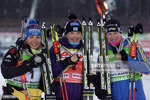 Kaisa Makarainen of Finland takes 1st place, Magdalena Neuner of Germany takes 2nd place, Helena Ekholm of Sweden takes 3rd place during the IBU...