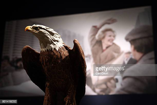 Kaiser Biscuit Model of an American Bald Eagle gifted to Margaret Thatcher by Ronald Reagan is displayed in front of a photograph of Margaret...