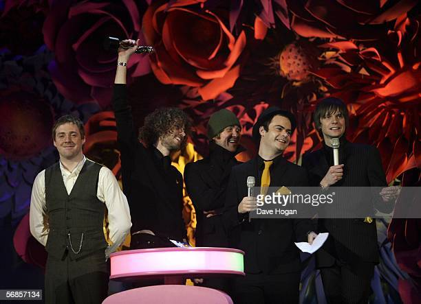 Kaiser Chiefs Ricky Wilson Simon Rix Nick Baines Andrew White and Nick Hodgson accept the award for Best British Rock Act on stage at The Brit Awards...