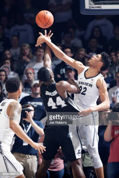 Kaiser Gates of the Xavier Musketeers blocks a shot against Isaiah Jackson of the Providence Friars in the second half of a game at Cintas Center on...