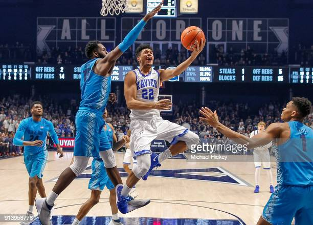 Kaiser Gates of the Xavier Musketeers shoots the ball against Jessie Govan of the Georgetown Hoyas at Cintas Center on February 3, 2018 in...