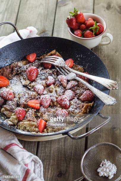 Kaiserschmarrn with fresh strawberries and icing sugar