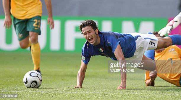 Australian defender Lucas Neill brings down Italian defender Fabio Grosso that resulted in a penalty kick for Italy at the end of the round of 16...