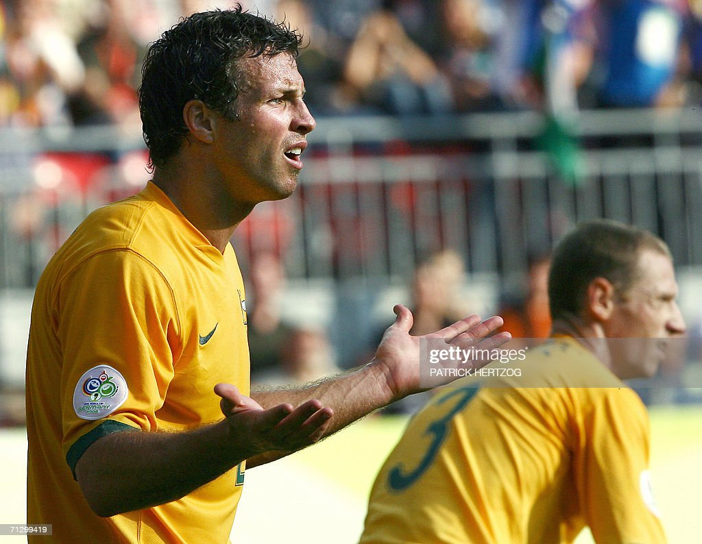 Australian defender Lucas Neill (L) protests after fouling Italian defender Fabio Grosso (not pictured) to create a penalty kick for Italy at the end of the round of 16 World Cup football match between Italy and Australia at Kaiserslautern's Fritz-Walter Stadium, 26 June 2006. Italy won the match 1-0 when a penalty kick was converted by Italian midfielder Francesco Totti at the end of the game.