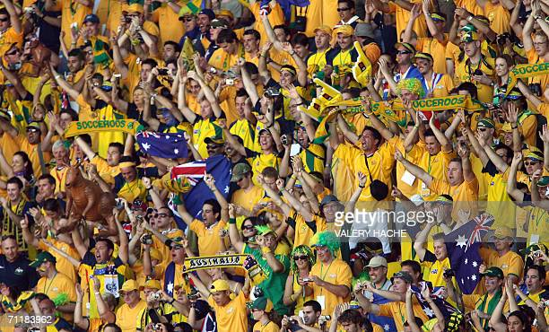 Kaiserslautern, GERMANY: Australian fans cheer their team's victory over Japan in their first round Group F World Cup football match at...