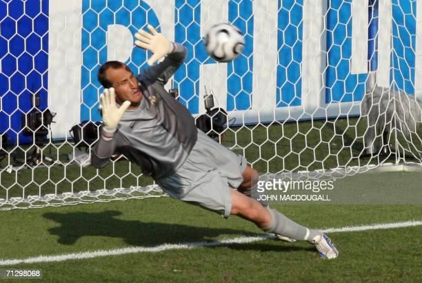 Kaiserslautern, GERMANY: Australian goalkeeper Mark Schwarzer dives in an attempt to block a penalty kick scored by Italian midfielder Francesco...
