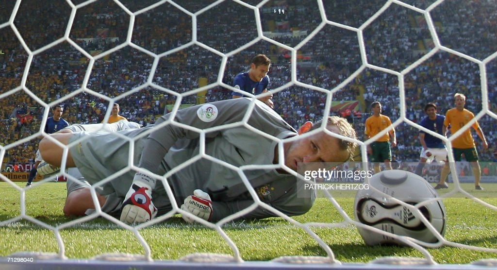 Australian goalkeeper Mark Schwarzer looks at the ball after giving up the winning goal on a penalty kick scored by Italian midfielder Francesco Totti during the round of 16 World Cup football match between Italy and Australia at Kaiserslautern's Fritz-Walter Stadium, 26 June 2006. Italy won the match 1-0.