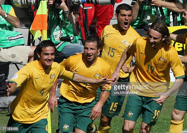 Kaiserslautern, GERMANY: Australian midfielder Tim Cahill celebrates with teammates after scoring his second goal against Japan in their first round...