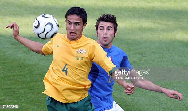 Australian midfielder Tim Cahill vies for the ball with Italian defender Andrea Barzagli in the round of 16 World Cup 2006 football match between...