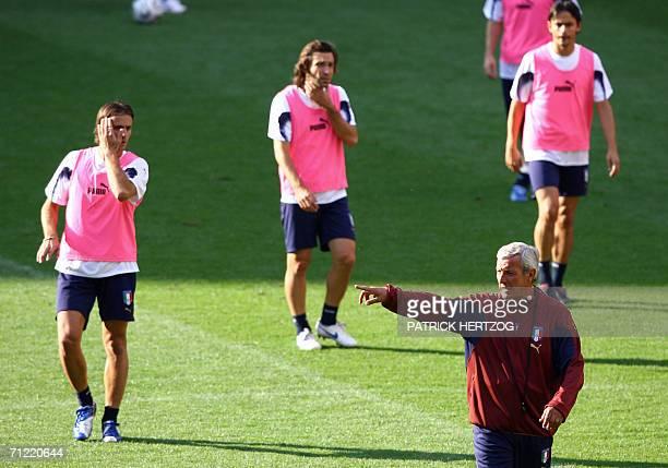 Kaiserslautern, GERMANY: Italian coach Marcello Lippi gestures as he gives instructions to his players Alberto Gilardino, Andrea Pirlo and Filippo...