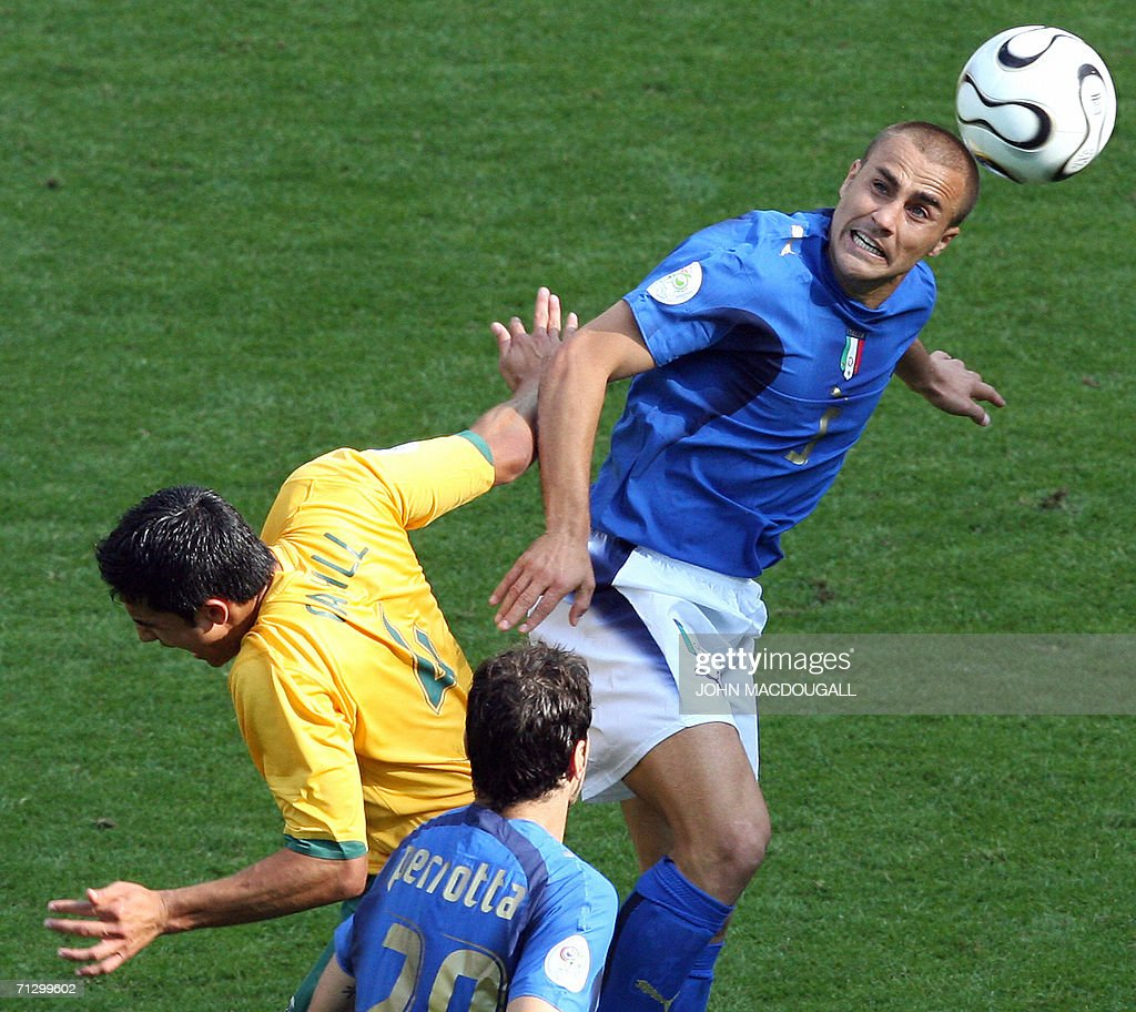 Italian defender Fabio Cannavaro (R) clashes with Australian midfielder Tim Cahill (L) as Italian midfielder Simone Perrotta (bottom) looks on during the round of 16 World Cup football match between Italy and Australia at Kaiserslautern's Fritz-Walter Stadium, 26 June 2006. Italy won the match 1-0 when a penalty kick was converted by Italian midfielder Francesco Totti at the end of the game.