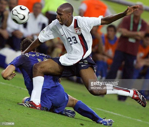 Kaiserslautern, GERMANY: Italian forward Alberto Gilardino vies with US defender Eddie Pope during the World Cup 2006 group E football match Italy vs...