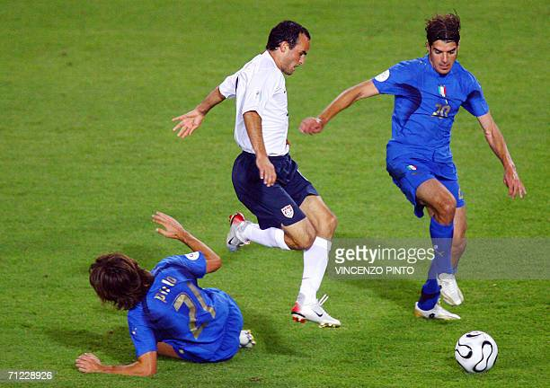 Italian midfielder Andrea Pirlo and Italian midfielder Simone Perrotta vie with US midfielder Landon Donovan during the World Cup 2006 group E...