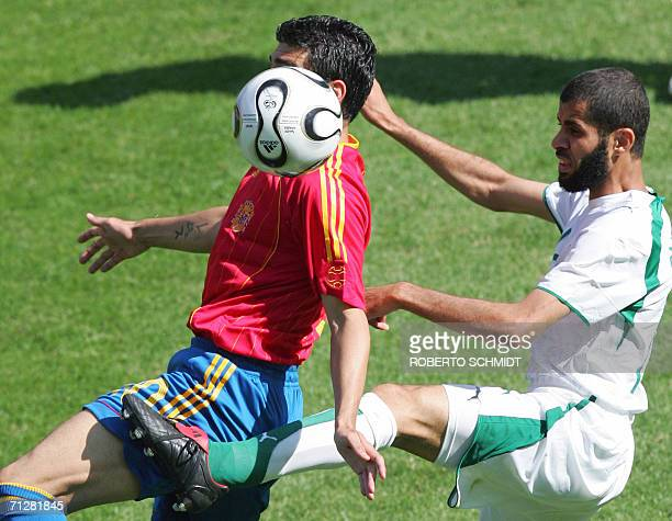 Saudi defender Abdulaziz Khathran fights for the ball with Spanish midfielder Jose Antonio Reyes during the opening round Group H World Cup football...