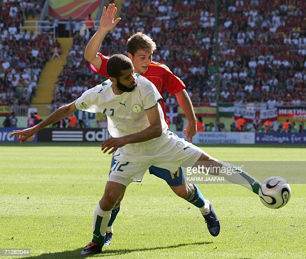 Spanish midfielder Joaquin vies with Saudi defender Abdulaziz Khathran during the opening round Group H World Cup football match between Saudi Arabia...