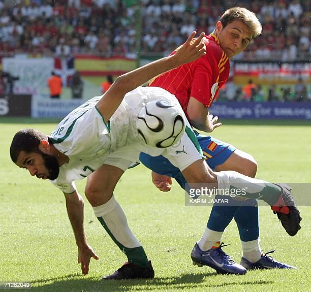 Spanish midfielder Joaquin vies with Saudi defender Abdulaziz Khathran during the opening round Group H World Cup football match between Saudi Arabia...