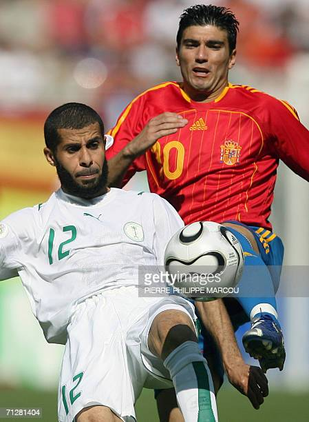 Spanish midfielder Jose Antonio Reyes challenges Saudi defender Abdulaziz Khathran during the opening round Group H World Cup football match between...