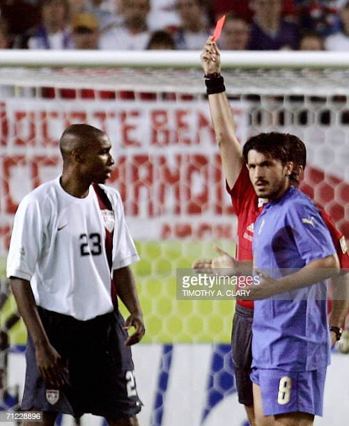 Kaiserslautern, GERMANY: Uruguayan referee Jorge Larrionda gives a red card to US defender Eddie Pope as Italian defender Andrea Barzagli reacts...