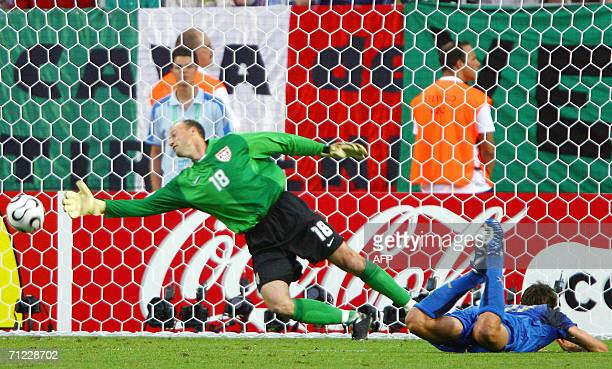 US goalkeeper Kasey Keller misses a goal by Italian forward Alberto Gilardino during the World Cup 2006 group E football match Italy vs USA 17 June...