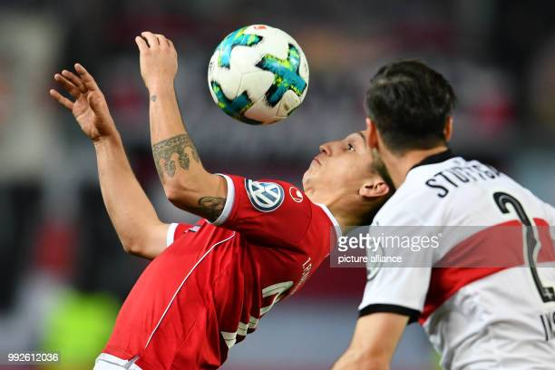 Kaiserslautern's Baris Atik and Stuttgart's Emiliano Insua Zapata vying for the ball during the DFBCup soccer match between 1 FC Kaiserslautern and...
