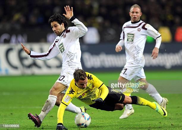 Kaiserslautern's midfielder Olcay Sahan and Dortmund's midfielder Mario Goetze vie for the ball during the German first division Bundesliga football...