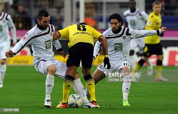 Kaiserslautern's midfielders Christian Tiffert and Olcay Sahan fight for the ball with Dortmund's Brazilian midfielder Antonio da Silva during the...